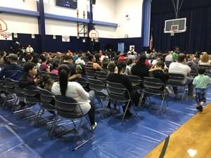 Parents gathering in the auditorium