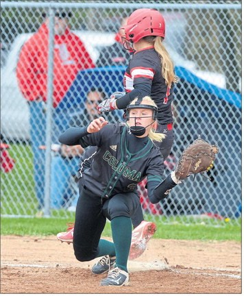Coloma's Hannah Mathis covers first base as Lakeshore's Meghan Younger is thrown out during the St. Joseph Invitational on Saturday