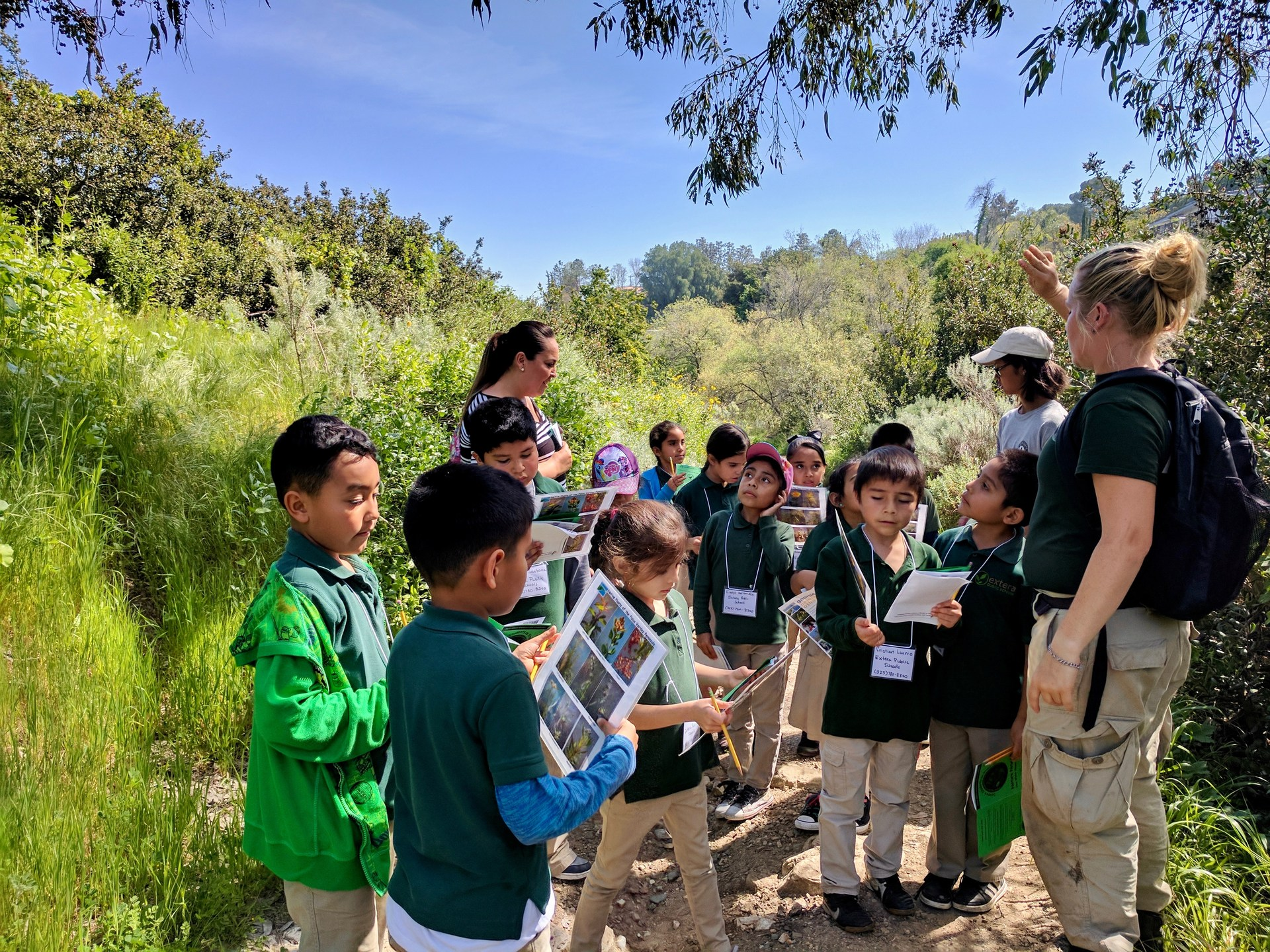 teacher leads students in a nature lesson