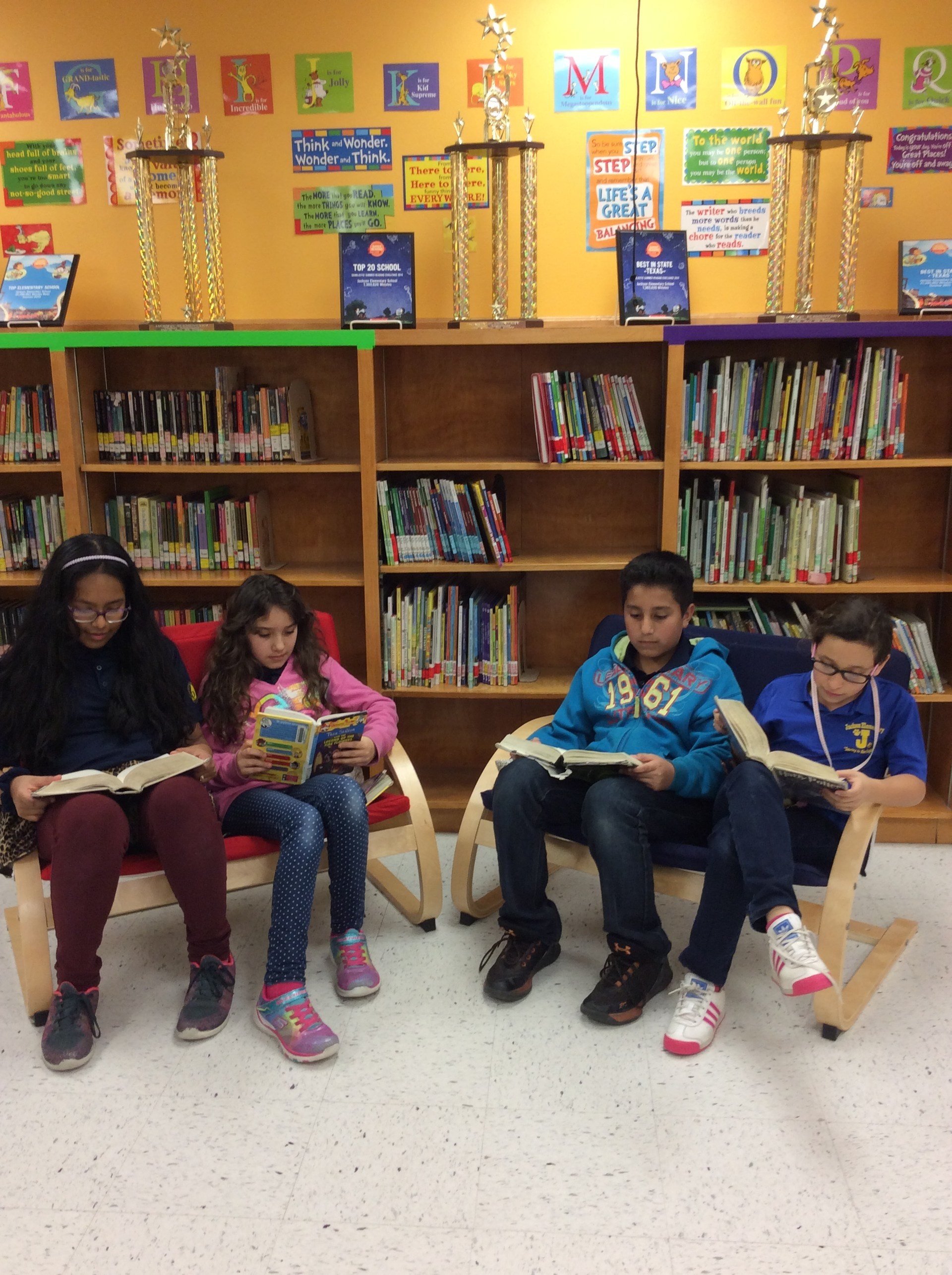students reading on the library couches