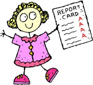 LIttle girl holding a report card