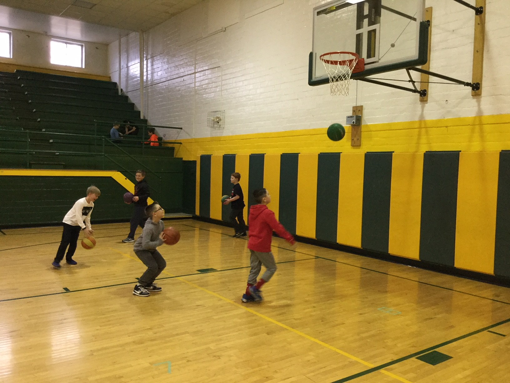 students playing basketball during perfect attendance social trimester 2