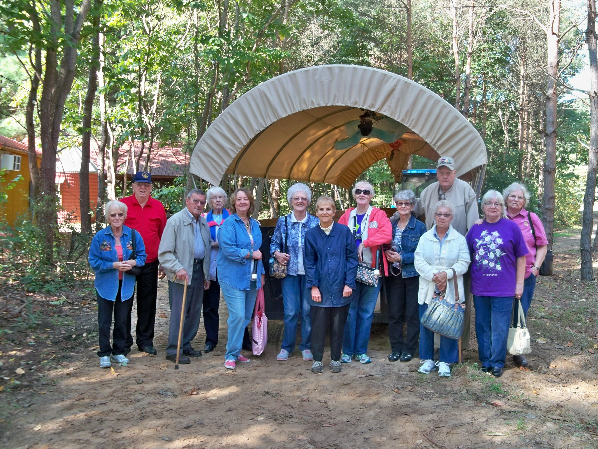 Seniors take a field trip to Stokes Homestead Farm Market and pose in front of their archway.