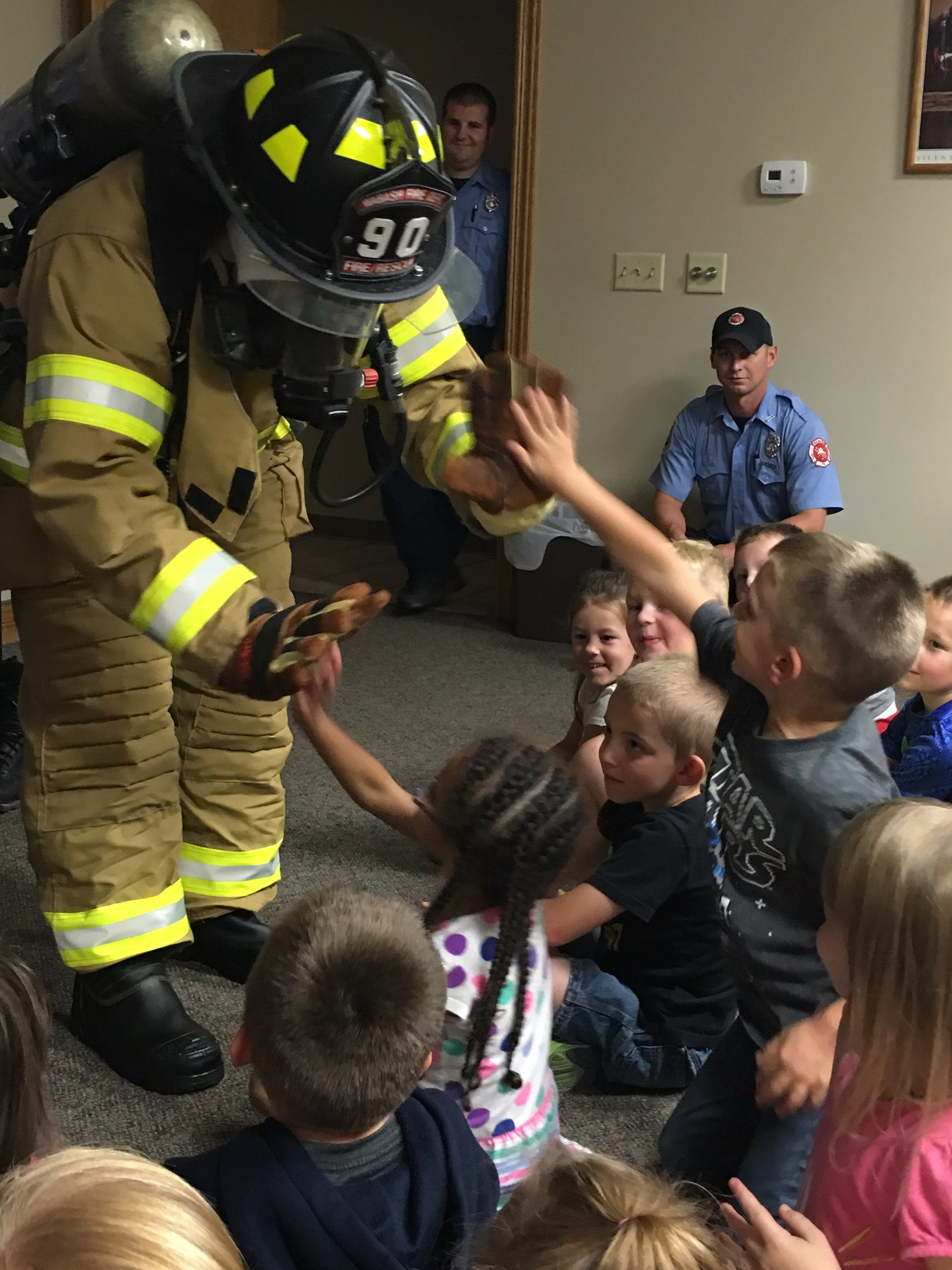 Students with fireman.