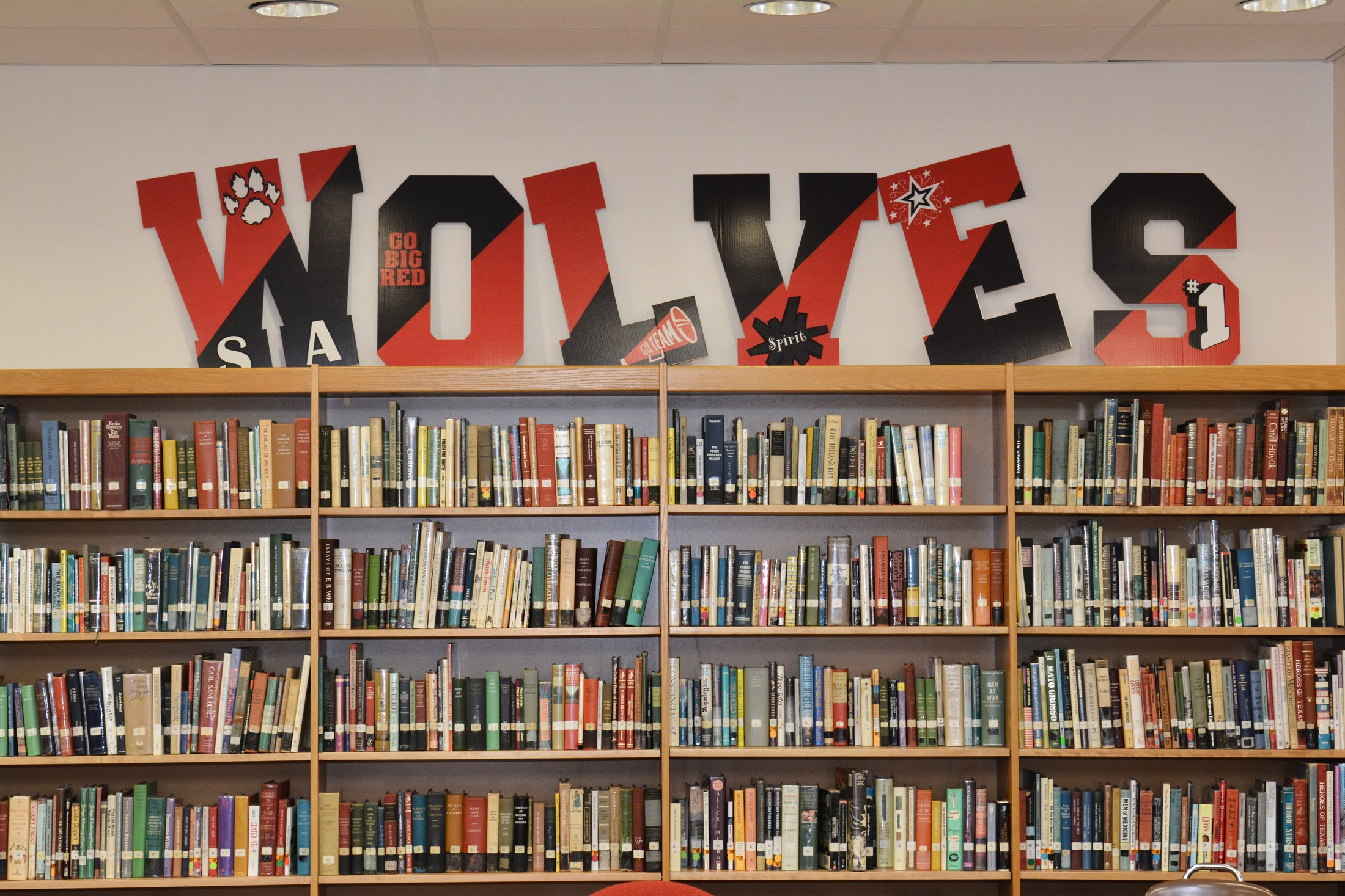 High School Library with WOLVES above the shelf.