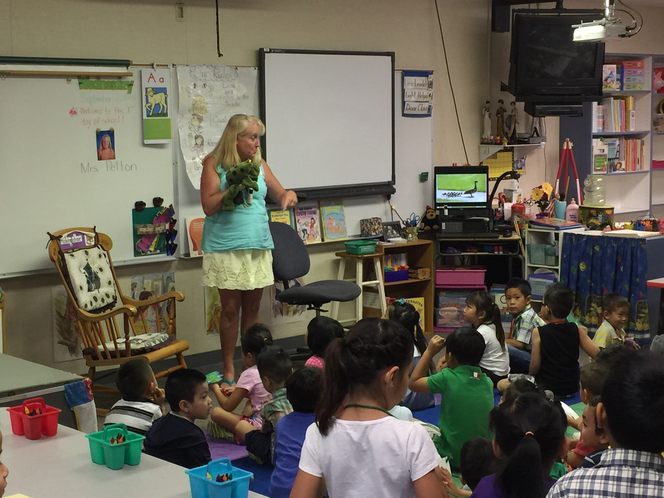Mrs. Pelton, her class and the frog