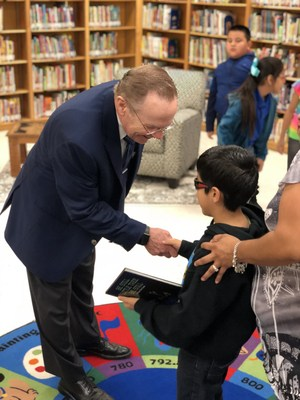 Ashton receives autographed book from Mayor Darling.