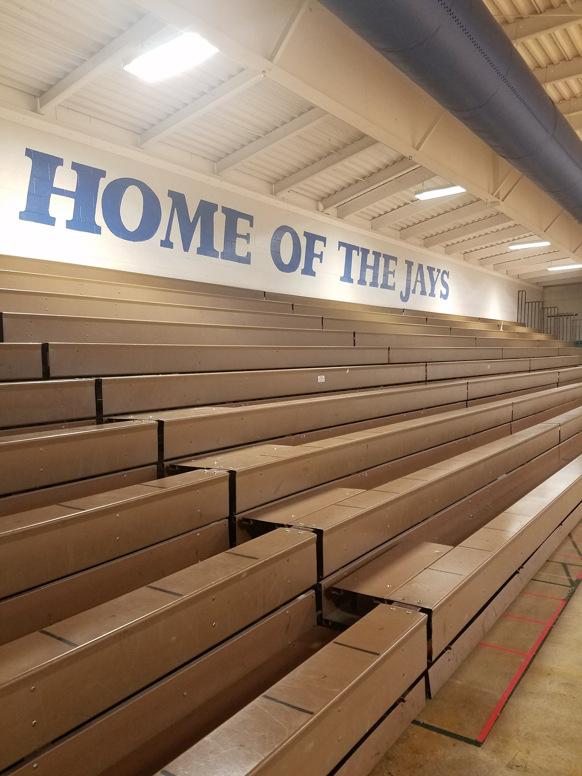 Home side bleachers of gymnasium