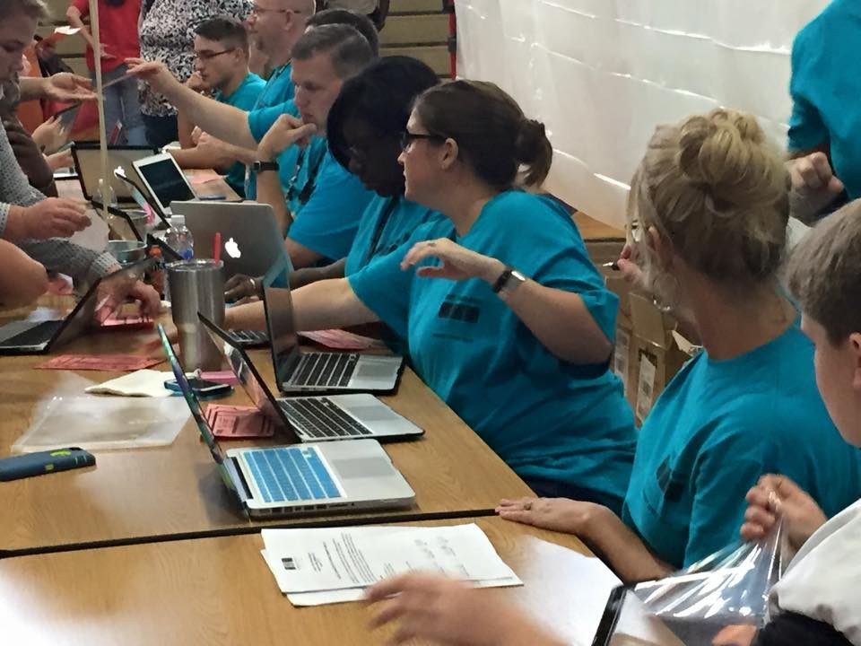 Technology Staff enrolling MacBooks