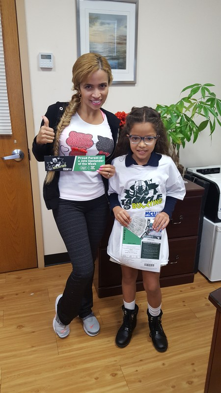 L. Ramirez and her mom stand as she is this weeks Upstander winner