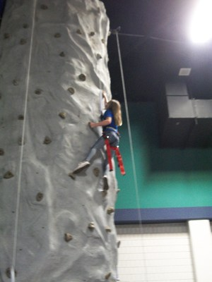 Student rock-wall climbing at the Greensboro Coliseum.