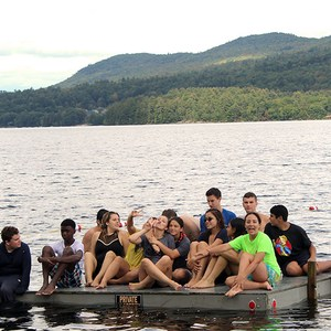 Students on a dock in the lake