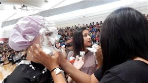 Game at rally - Shaving cream on face