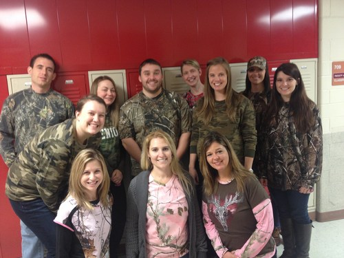 Teachers  wearing cammo showing their support for a student struck with cancer.