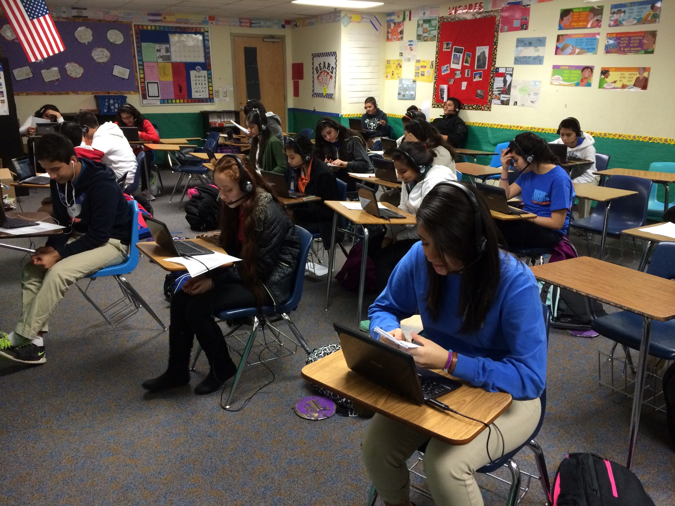 Students working on devices in the classroom