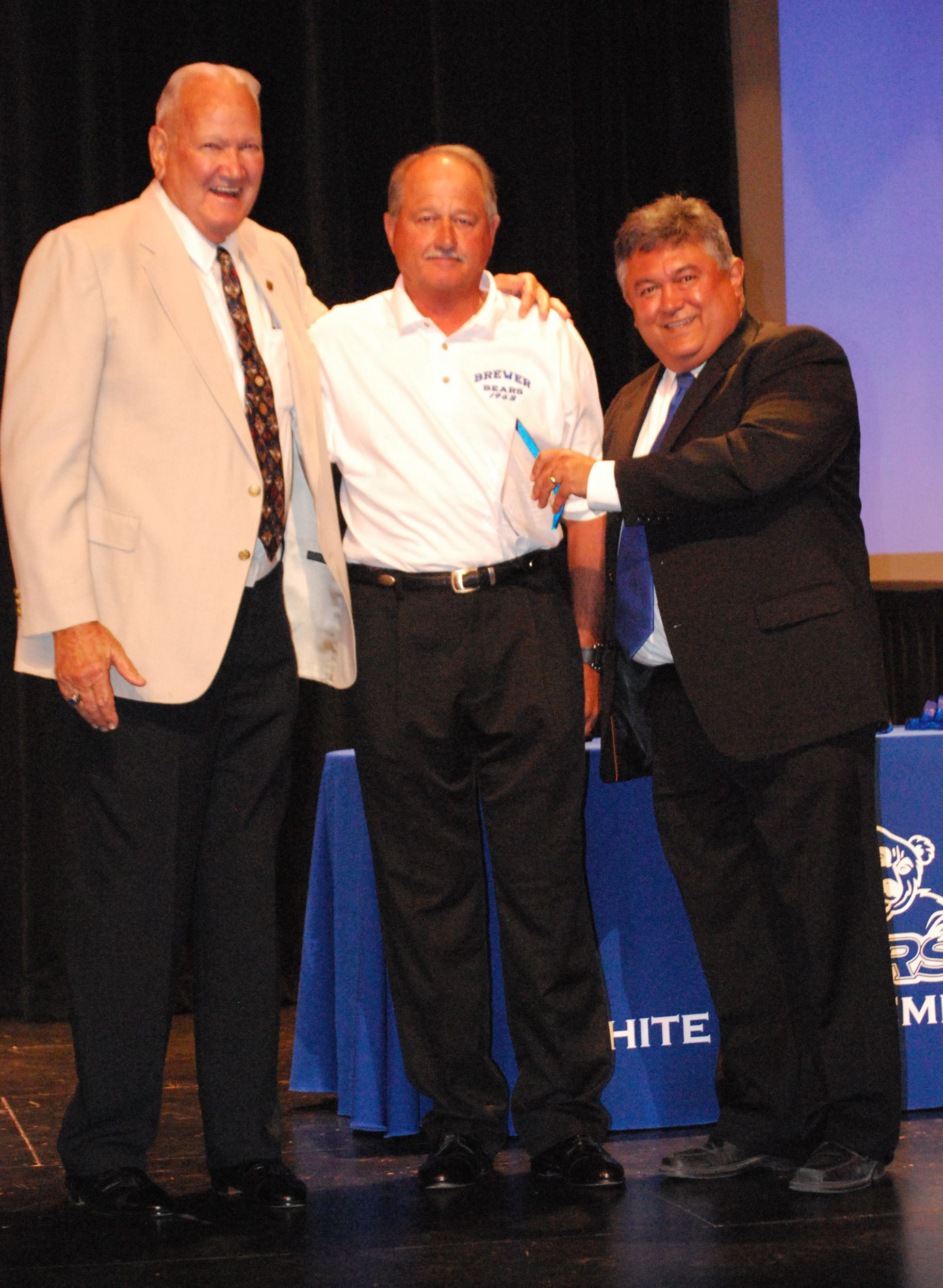 George Clark is pictured with Coach Don Walker and Superintendent Frank Molinar.