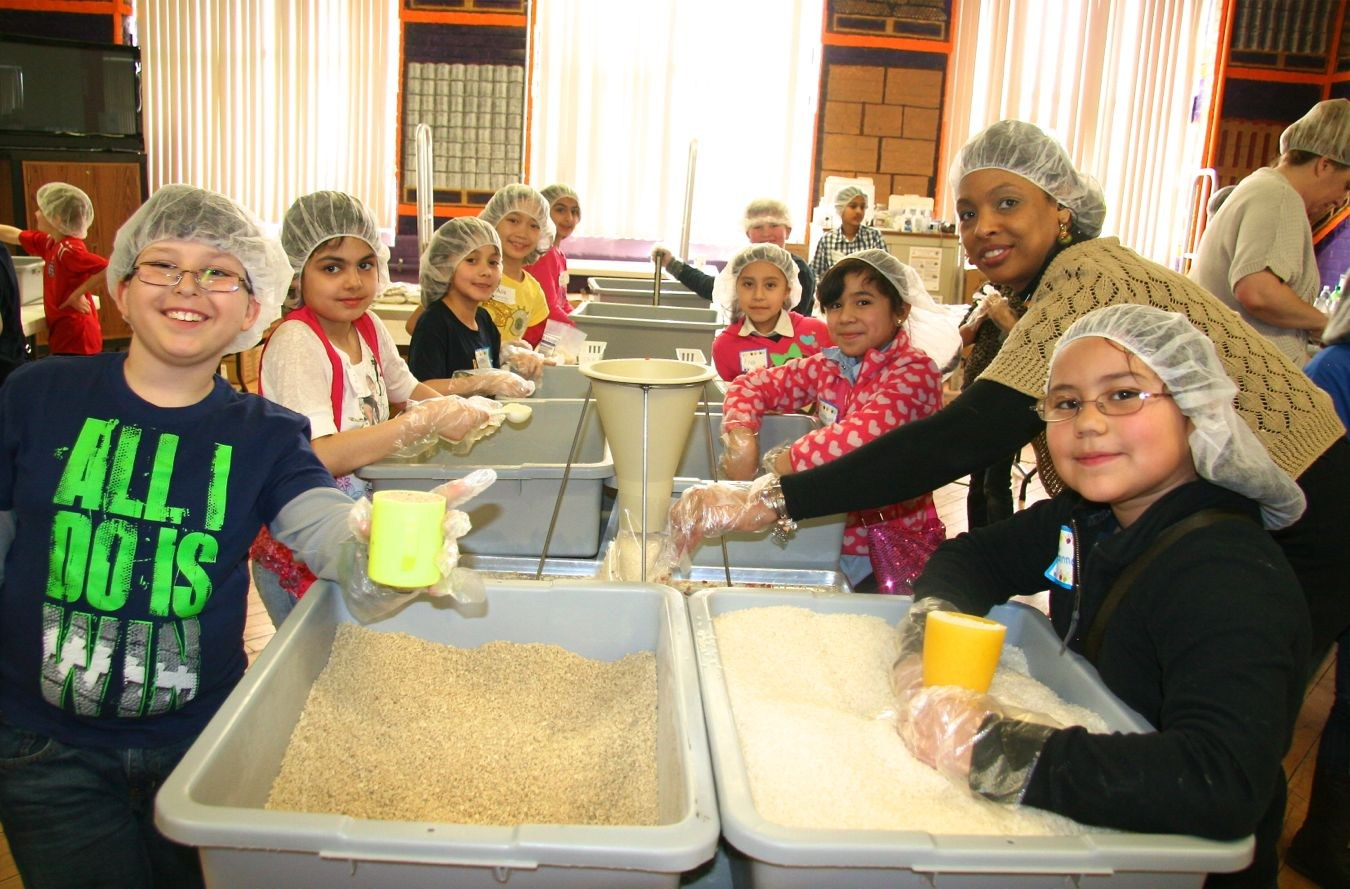 Northville elementary students with their partner school peers, packing food for Kids' Against Hunger.