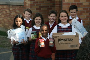 Group of kids holding food items.