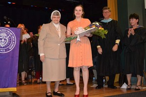 Katie Dickey '18 receives the Blessed Angela Award and poses with Sr. Justice.