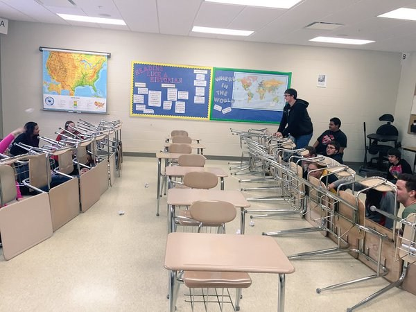US II students reviewing for WWI by playing trench warfare