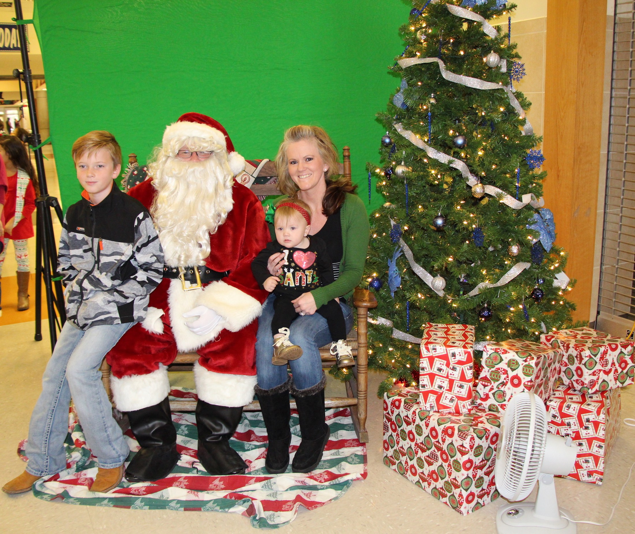 Kids have their picture with santa