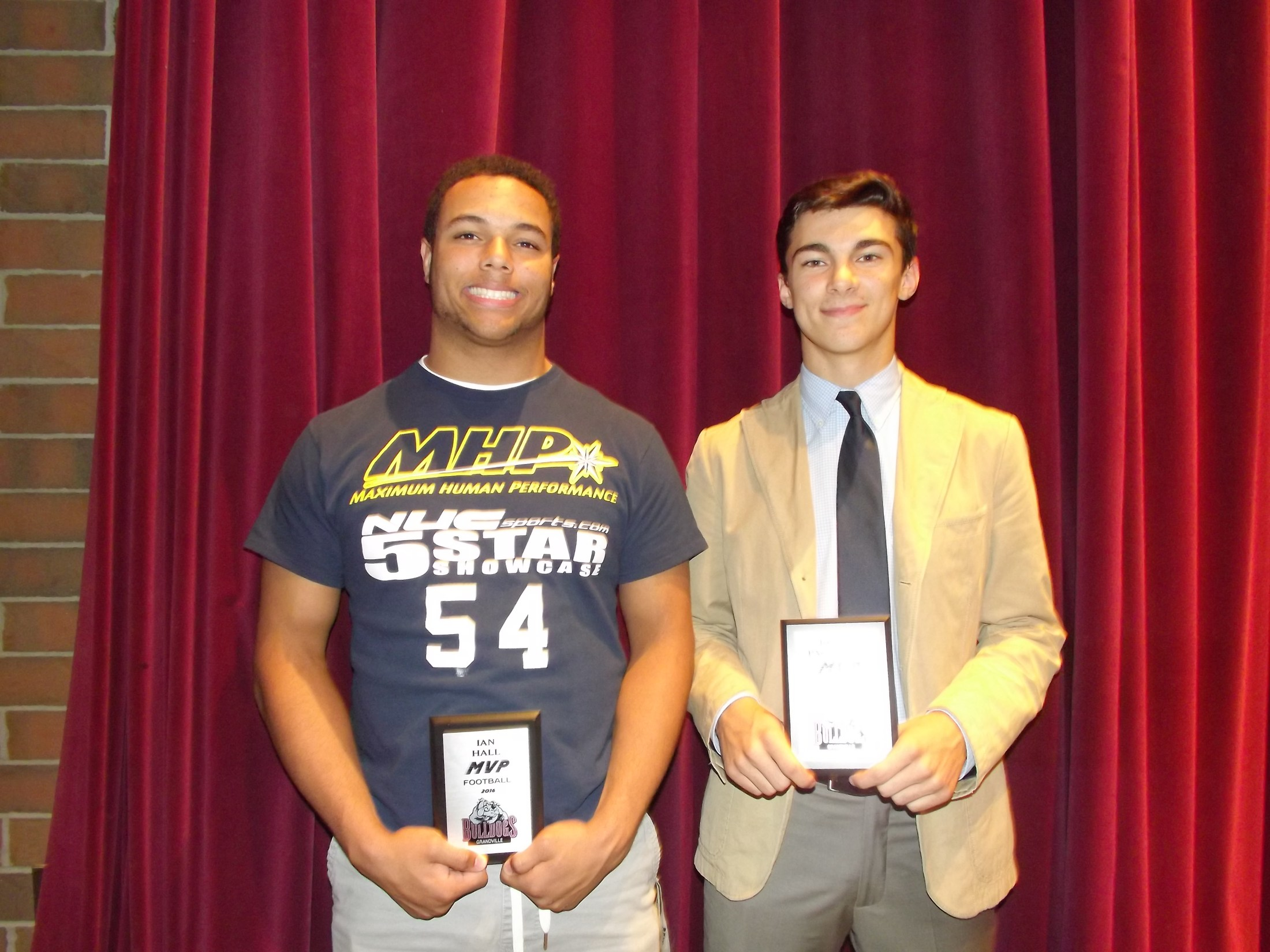 two boys with football MVP award