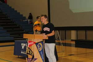 Student announcing his college at college signing day