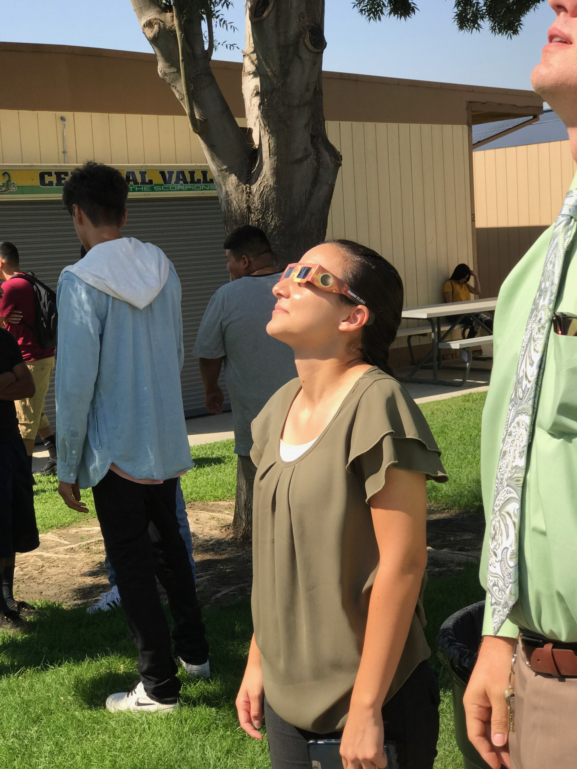 Ms. Wilson observes the solar eclipse