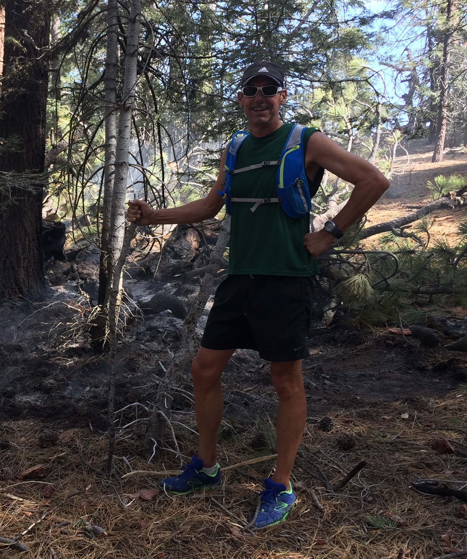 Posing in front of smoldering forest fire while on a trail run.