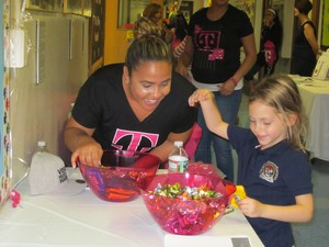 T Mobile Representative giving a child candy