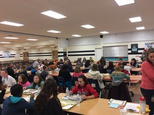 Students sitting in cafeteria during the V.I.P. breakfast.