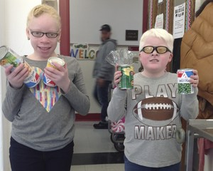 Two Schermerhorn students collecting cans.
