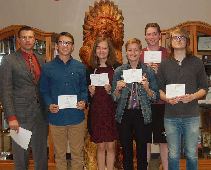 Photo of the Fairfield High School Commended Students in the National Merit Scholarship Program to their list of accomplishments. They are: Ryan Finnerty Emma Hynes Benjamin Timmester Lydia Unklesbay Ethan Verquer