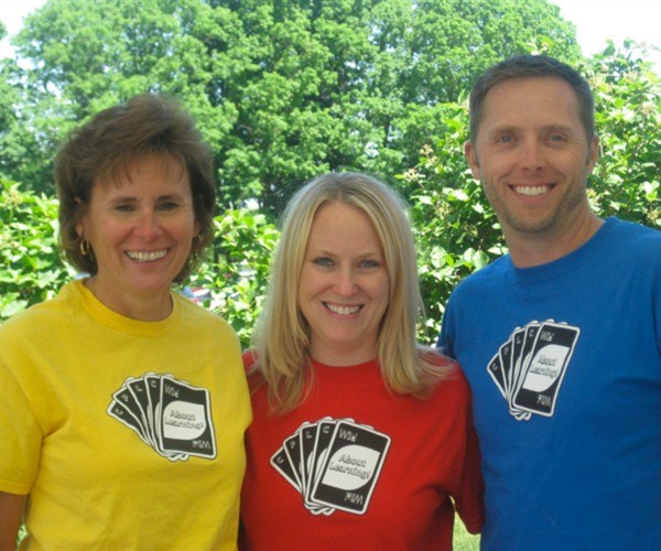 teachers smiling with playing cards on their shirts