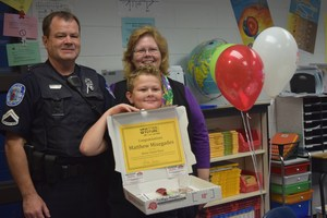 Matthew Misegades, a fifth grade student at Patrick Copeland Elementary, is all smiles as he stands with his parents after being named a Better Future Fund Winner on April 18.