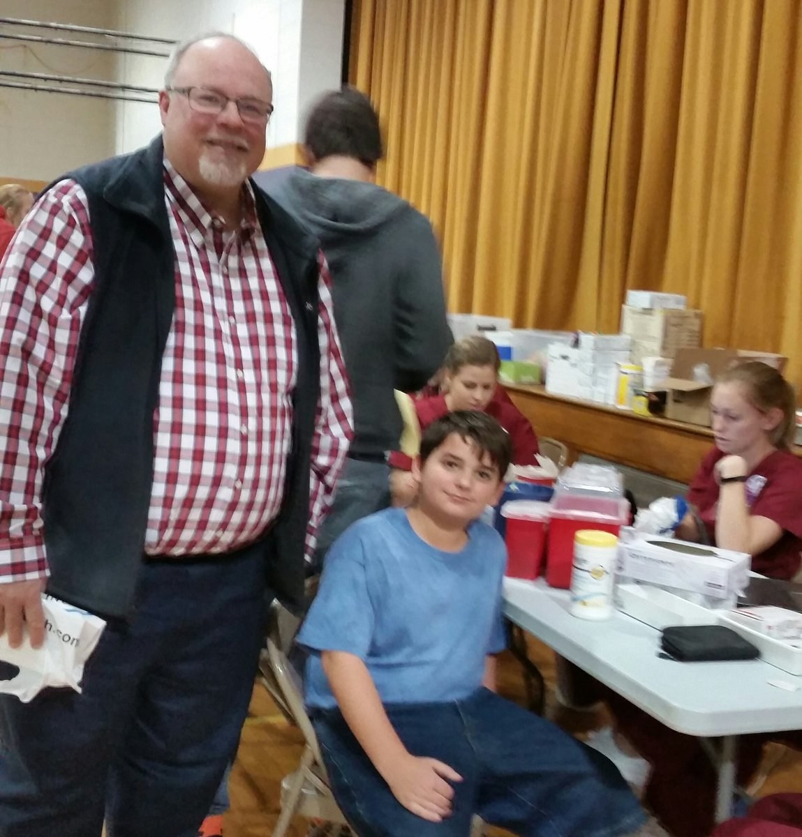 Superintendent Duane McGee visits with Jacob Oglesby at the CMS Health Fair.
