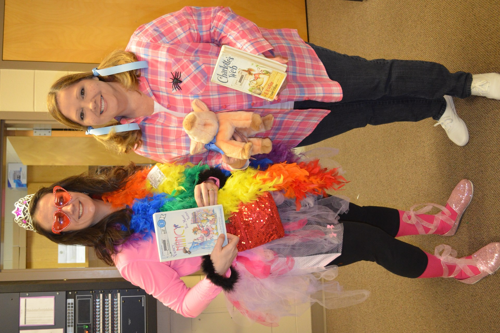 Fern from Charlotte's Web (BES principal) and Fancy Nancy (BES receptionist) run the office on Read Across America Day.