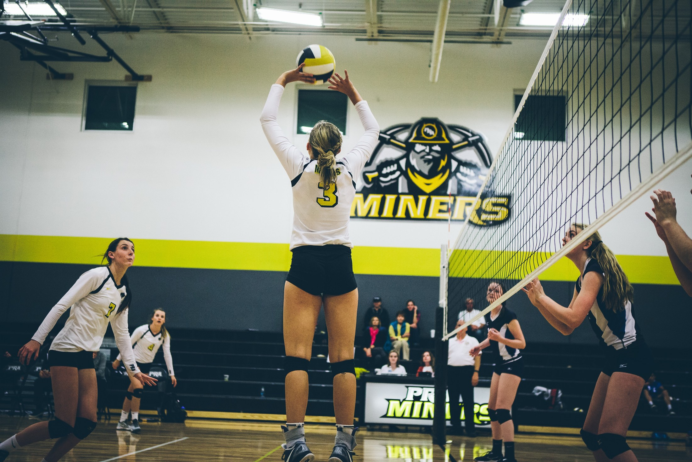 Volleyball player creating a set