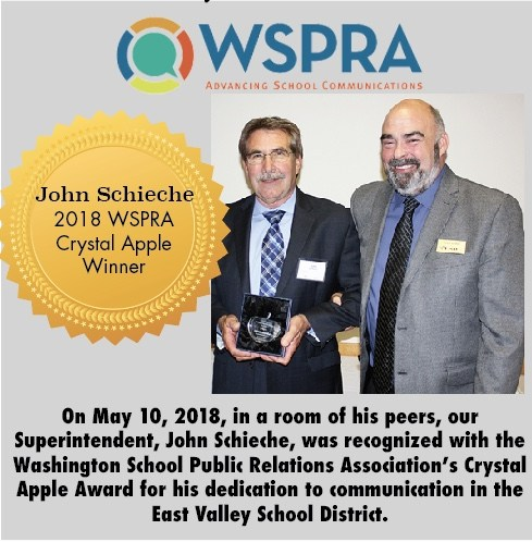 Picture of John receiving the Washington School Public Relations Association's Crystal Apple Award with ESD 105 Superintendent, Kevin Chase.