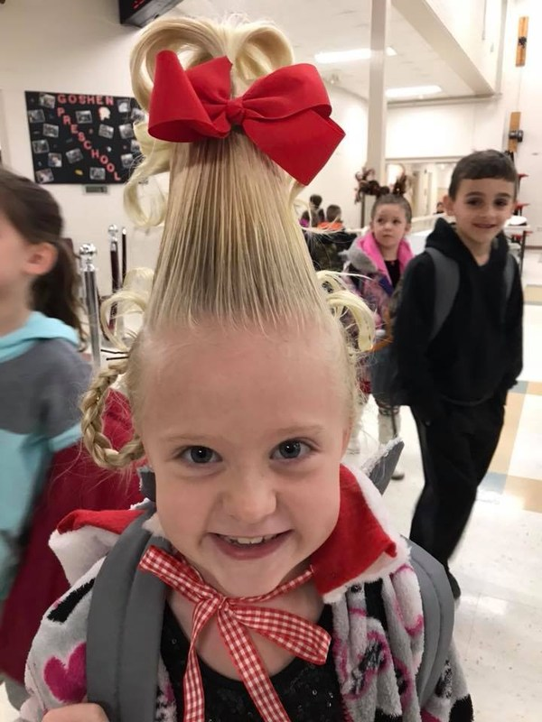 first grade student dressed up like Cindy Lou Who