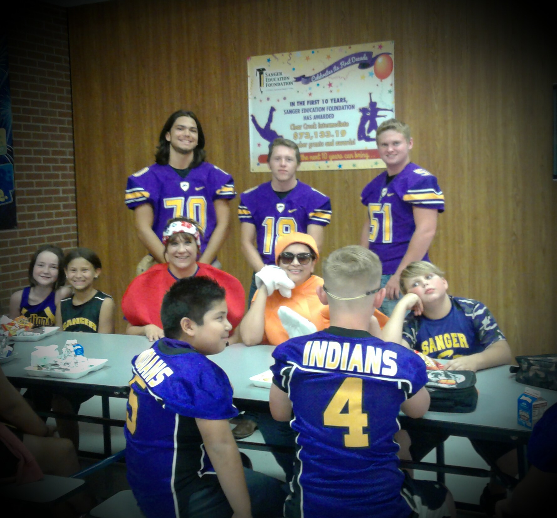 SHS Football players work with Chisholm Trail Elementary Students