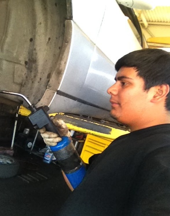 Student working on car.