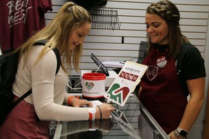 Students at Magnolia High school donating at the bookstore.jpg