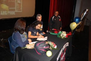 Hazel signing letter of intent to play college softball.