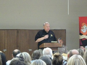 Guest speaker, sheriff, addresses audience.