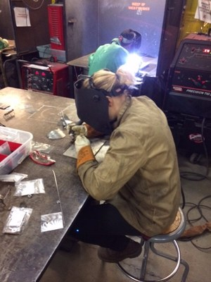 girl welding