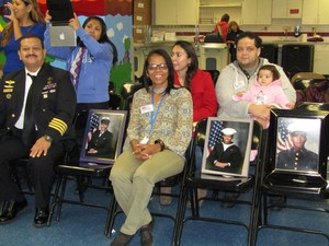 Mrs. Fransisco proudly sits amongst the photo of her daughters in service to this country