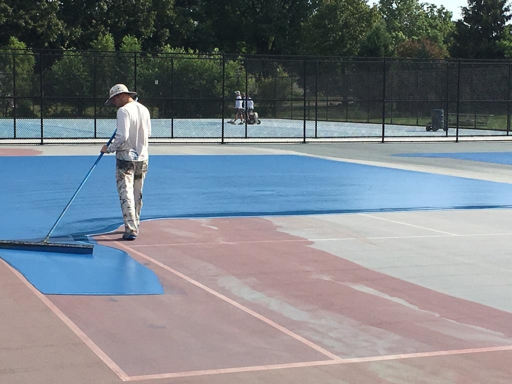 The tennis courts get resurfaced.
