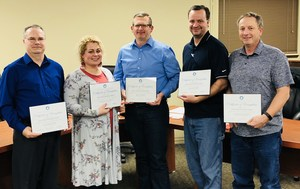 East Valley Board of Directors holding recognition certificates. From left: Matthew Byers, Charlotte Layman, Eric Farmer, Seth Basford, Ray Wiseman.
