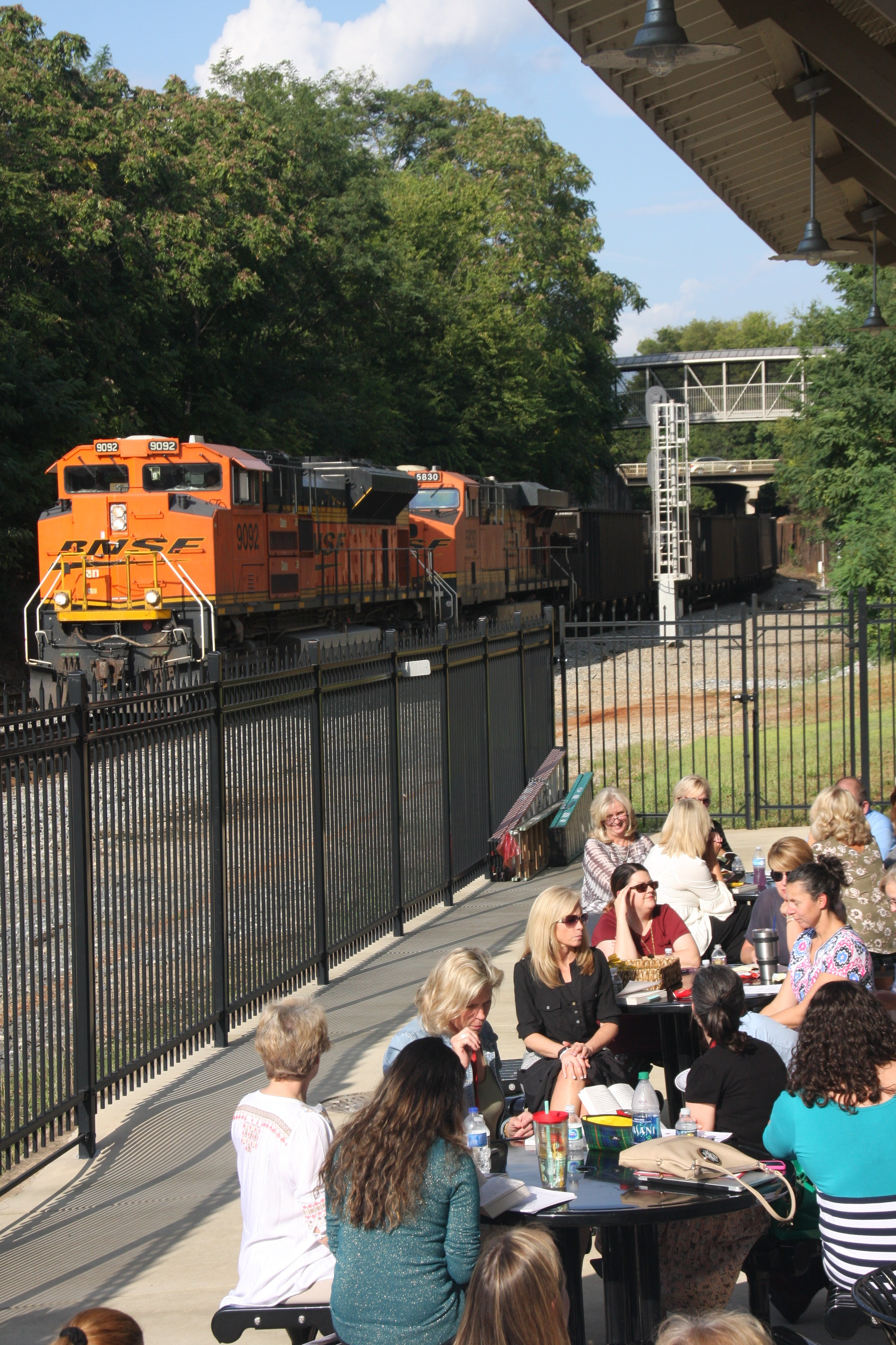 Book study members pause for a train to pass at the second session held at Decatur's Historic Train Depot.